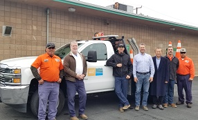 Seven member of GWSD staff standing infront of a pickup